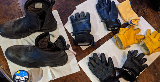 Gloves and boots on table