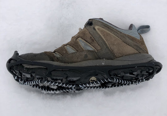 Woman's hiking shoe with attached cleat